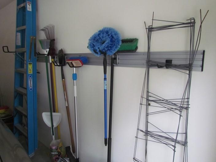 Brooms shovels yard tools atlanta closet for Omni garage door