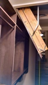Attic stairs in a walk-in closet required the shelving to be a custom depth