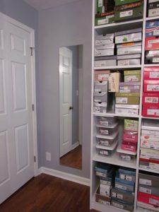 Door in corner of closet creates unusable space on the adjacent wall