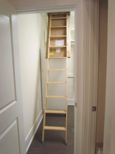 Attic stairs located close to a wall prevent the wall from being used for storage