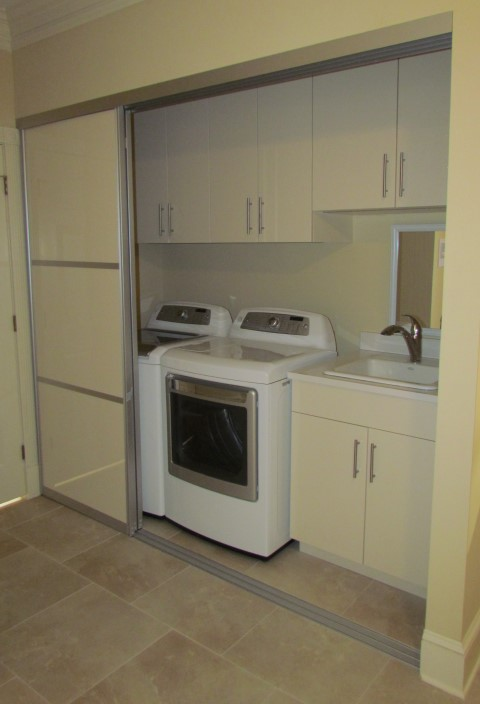 Almond Cabinets Sink Behind Aluminum Sliding Door Sable Glow Laundry ...
