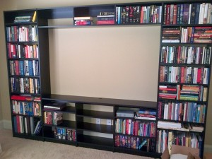 Black melamine bookshelves surround space for a flat screen TV