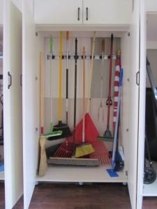 Broom Holders Behind Doors