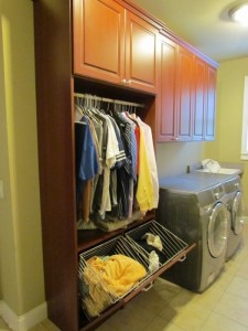 Floor-to-ceiling Lexington Laundry Hutch & Hampers with Crown Molding and Satin Nickel Knobs