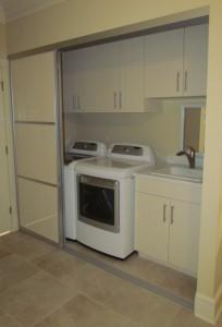 Almond Cabinets Sink behind Aluminum Sliding Door