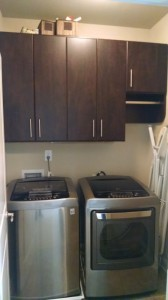 Sable Glow Laundry Cabinets with Contemporary Satin Nickel Pulls and Oval Rod