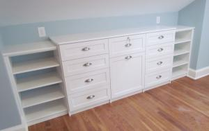 Built in with drawers tucked under low sloped ceiling