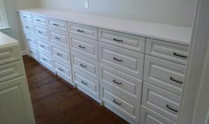 Long wall-to-wall built In dresser
