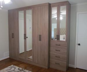 Master bedroom built in wardrobe with mirrored doors