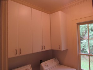 Tall Upper Slab Face Cabinets with Traditional Satin Nickel Pulls