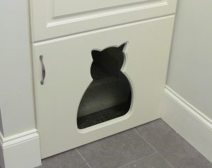 Close up of custom littler box door with kitty shaped opening