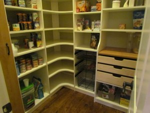 Walk-in Pantry with Corner Shelves, Wire Baskets and Maple Pullouts