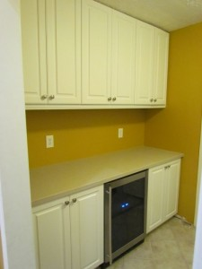 Lexington Cabinets, Wine Cooler, Solid Surface Counter and Ribbed Satin Nickel Knobs