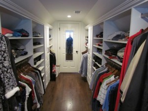 White Galley Closet with Crown Molding and Mirror