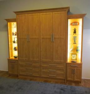 Murphy bed appears to be a large hutch with drawers and doors