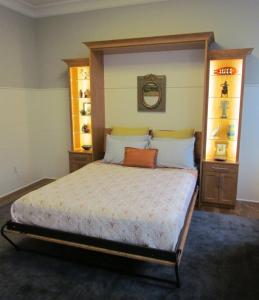 Murphy bed opens to reveal a queen-sized mattress
