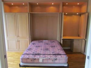 Vintage oak Murphy Bed with tall bifold pocket doors and full size mattress